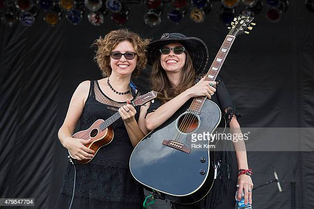 Musicians/singers Cathy Guthrie and Amy Nelson of Folk Uke pose onstage during Willie Nelsons 4th of July Picnic at Austin360 Amphitheater on July 4...
