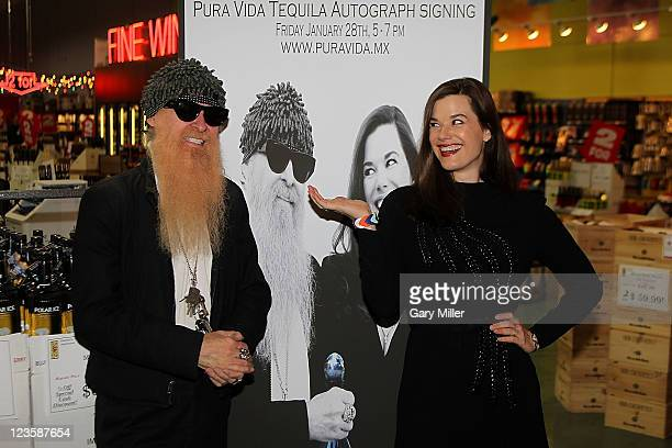 Musician/vocalist Billy Gibbons of ZZ Top and his wife Gilligan Gibbons pose after a signing of Pura Vida Tequila at Gabriel's Liquor on January 28...