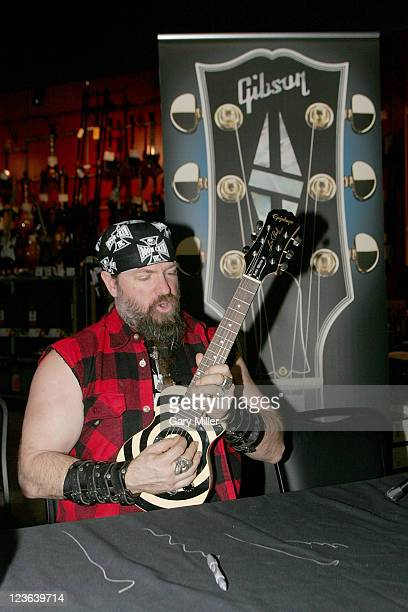Musician/vocalist Zakk Wylde signs his signature kid sized Epiphone Les Paul guitar at Best Buy on November 1 2010 in Austin Texas