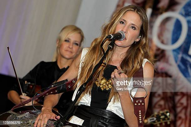 Musician/vocalists Martie Maguire and Emily Robison of Court Yard Hounds perform in concert during The Nobelity Project Dinner at the Four Seasons on...