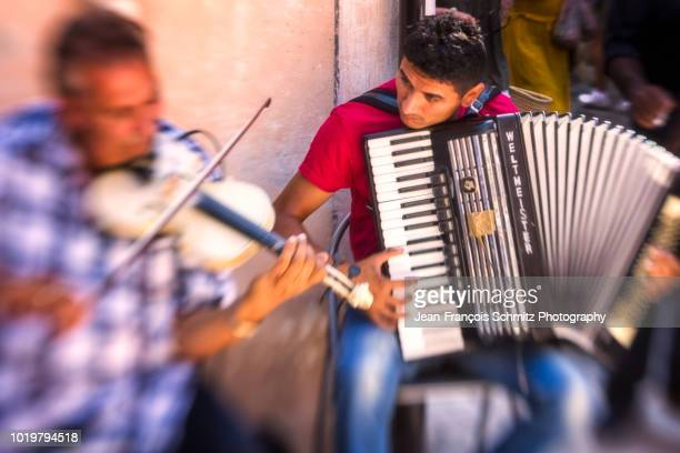 musiciens on the market in provence, july 2012 - accordionist stock pictures, royalty-free photos & images
