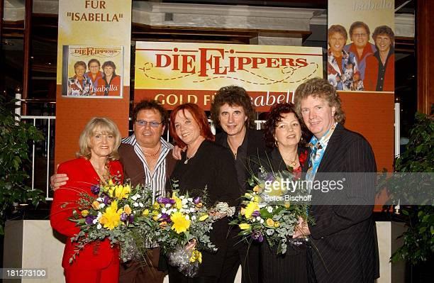 Musikgruppe 'Die Flippers' und Ehefrauen Manfred Durban mit Ehefrau Helene Olaf Malolepski mit Sonja und Bernd Hengst mit Edith Relais ChateauxHotel...