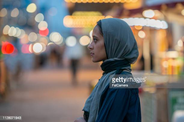 musim woman in city - emigration and immigration stock pictures, royalty-free photos & images