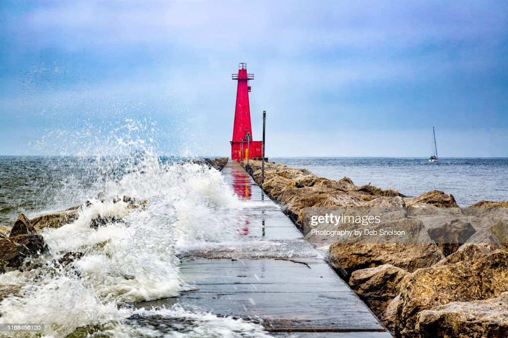 Muskegon Channel South Pier Lighthouse and Wave, Lake Michigan : Stock Photo