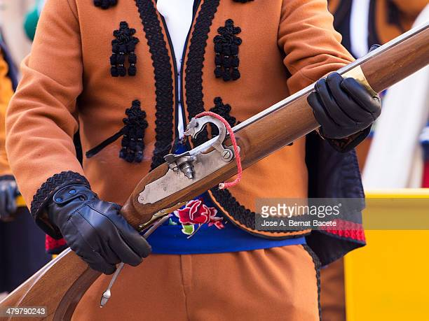 Musket in position of shot held by a Musketeer