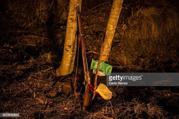 A musket leans against a tree during 'La Festa del Pi' in the village of Centelles on December 30 2015 in Barcelona Spain Early in the morning men...