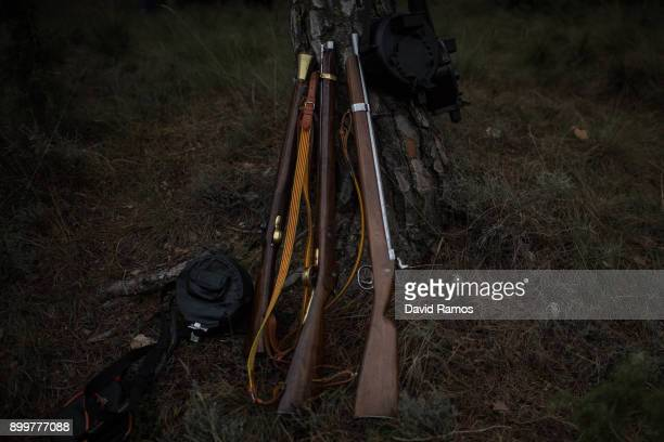 Muskets lean on a tree during 'la Festa del Pi' on December 30 2017 in Centelles Spain Early in the morning men and women born in Centelles who are...