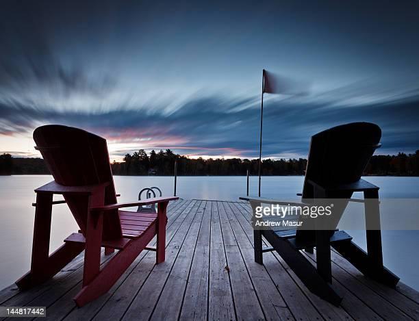 Muskoka chairs on dock