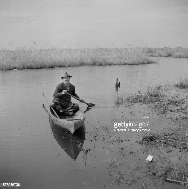 Muskrat Trapper Paddling Canoe near Delacroix Island Louisiana USA Marion Post Wolcott for Farm Security Administration January 1941