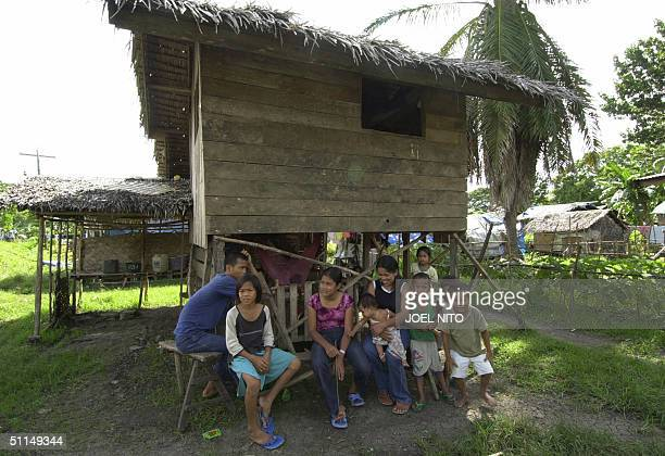 Muslem family rests under shade of a wooden hut at an evacuation camp in the town of Pagalungan in the troubled island of Mindanao in the southern...