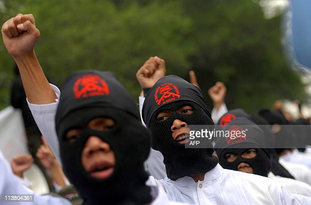 Muslim activists attend a rally for youths to swear to die in retaliation for the death of Osama bin Laden in Solo Central Java on May 6 2010 About...