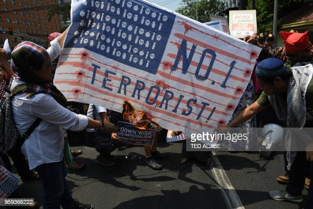 Muslim activists burn a mock US flag during a rally in support of the Palestinian cause near the US embassy in Manila on May 17 2018 At least 2400...