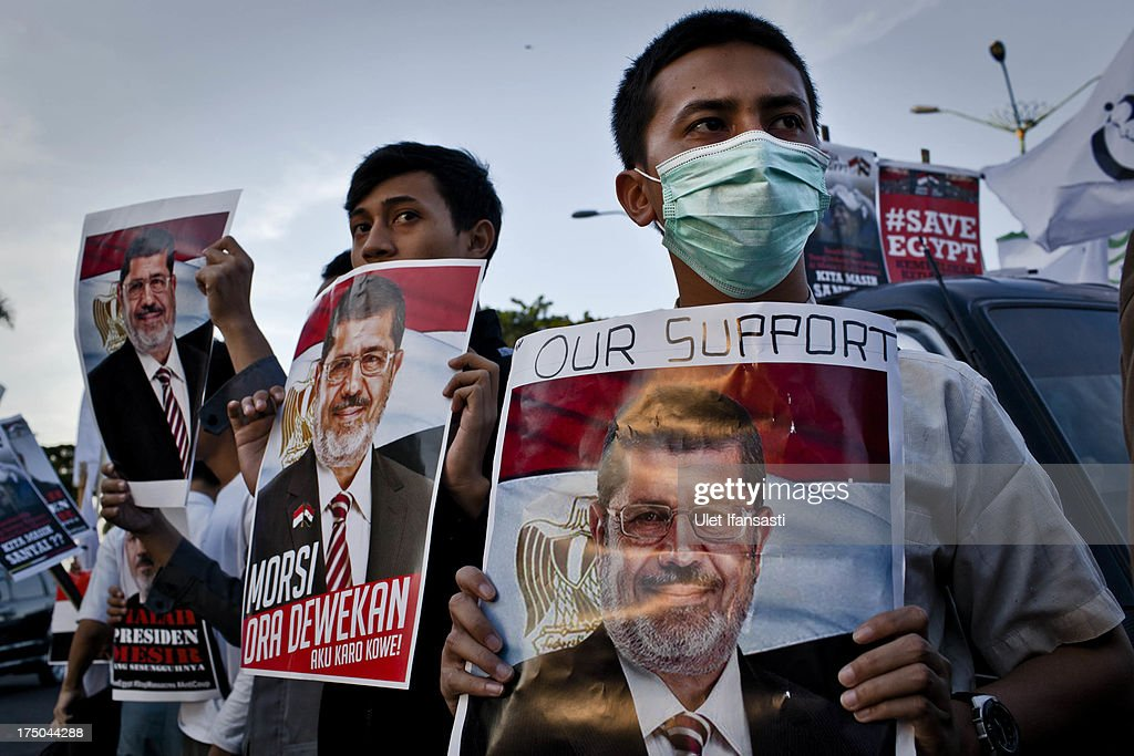 Muslim activists from the Youth Alliance Care for the Muslim World (Aliansi Pemuda Peduli Dunia Islam) hold posters of deposed Egyptian President Mohammed Morsi during a protest against the removal of Morsi in Egypt, on July 30, 2013 in Yogyakarta, Indonesia. The Youth Alliance Care for the Muslim World is urging Indonesian President Susilo Bambang Yudhoyono to take action over alleged crimes against humanity in Egypt.