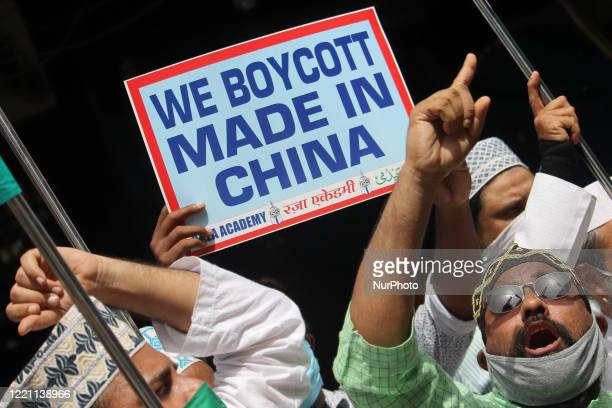 Muslim activists hold placards and shout slogans against China during a protest in Mumbai India on June 20 2020 The Indian Army said on Tuesday that...