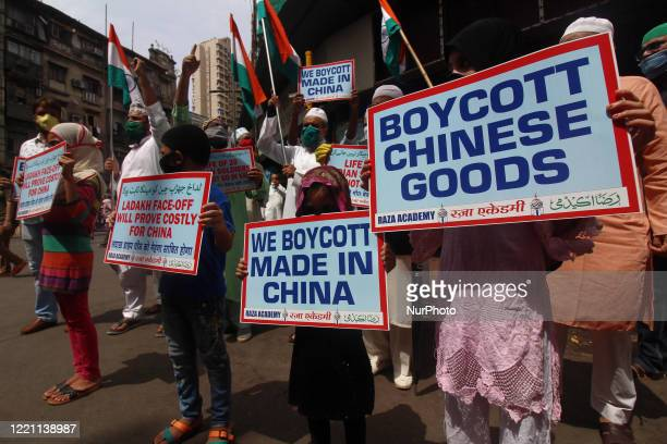 Muslim activists hold placards and shout slogans against China during a protest in Mumbai, India on June 20, 2020. The Indian Army said on Tuesday...