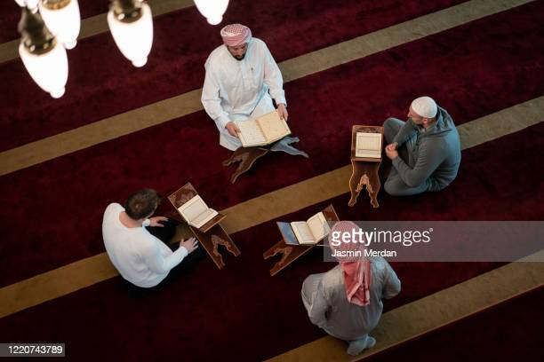 muslim adults learning koran together in mosque - イマームホメイニ広場 ストックフォトと画像