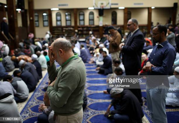 Muslim Americans take part in Friday prayers at the Dar Al Hijrah Islamic Center March 15 2019 in Falls Church Virginia 49 people were killed in a...