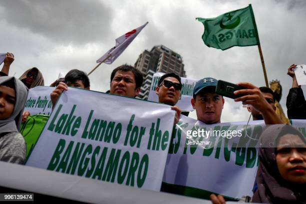Muslim and Christian activists hold a picket during the bicameral talks between Philippine senate and congress that would determine the fate the...