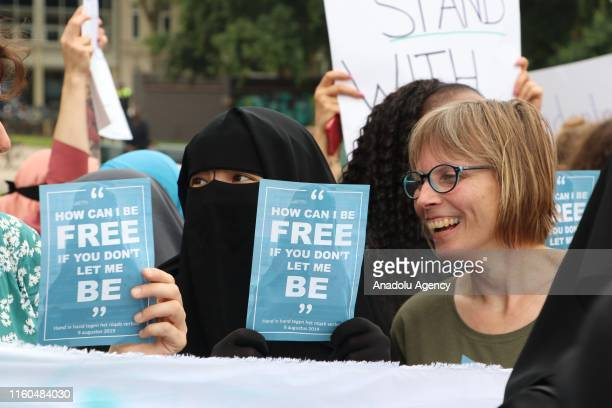 Muslim and nonmuslim women stage a protest against the burqa ban which was come into effect on August 1st at Koekamp Square to raise awareness for...