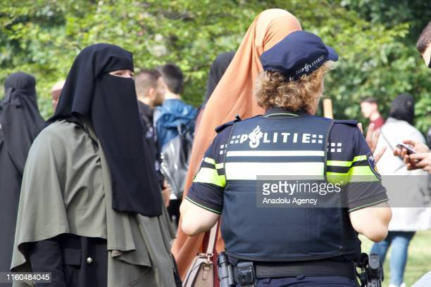 Muslim and non-muslim women stage a protest against the burqa ban, which was come into effect on August 1st, at Koekamp Square to raise awareness for...