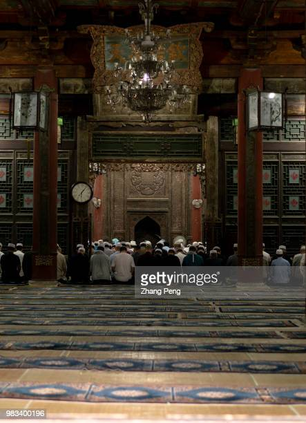 XI'AN SHAANXI PROVINCE CHINA Muslim believers pray in the main hall of Xi'an Great Mosque Xi'an Great Mosque which is a blend of traditional Chinese...