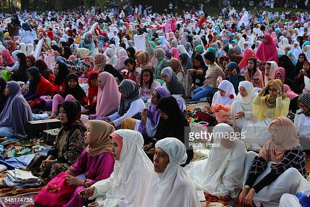 Muslim believers praying on Eid in Kebun Raya Bogor Indonesia