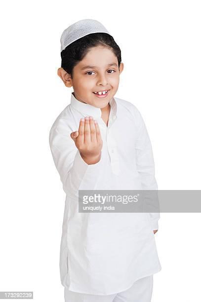Muslim boy greeting and smiling