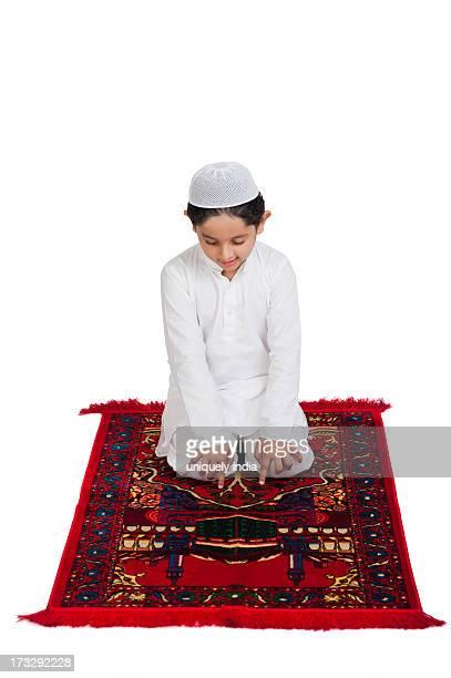 muslim boy praying - kurta stock pictures, royalty-free photos & images