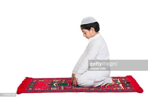 muslim boy praying - salah islamic prayer stock pictures, royalty-free photos & images