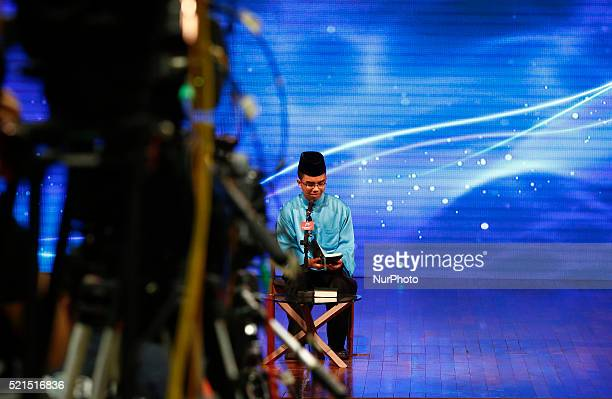A Muslim boy recites the holy Quran during public talk at University Science of Malaysia George Town on April 15 2016