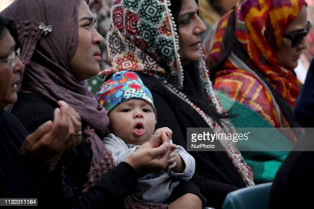 A Muslim boy yawns as his mother and others attend Friday Islamic prayers in Hagley Park outside the Masjid Al Noor mosque in Christchurch New...