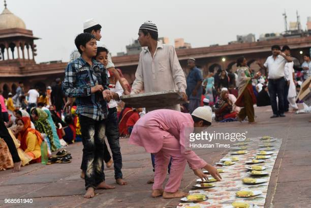 Muslim boys prepare food for fellow Muslims before breaking the fast on the 21st day of holy fasting month of Ramadan at Jama Masjid on June 6 2018...