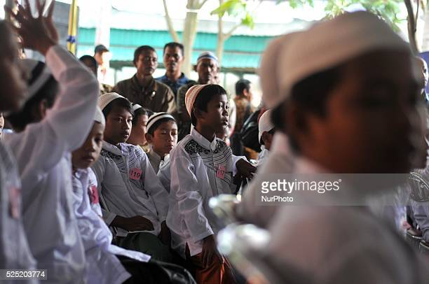 Muslim boys standing in line waiting for their turn while participating in the annual mass circumcision in Karanganyar Central Java Indonesia on...