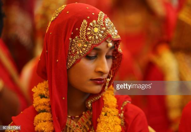 A Muslim bride looks on during a mass marriage ceremony organised under the 'CM Nikah scheme' of Madhya Pradesh state in Bhopal on March 5 2018...