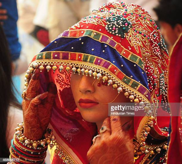 Muslim bride waiting for her turn during a mass marriage ceremony organised under 'CM Nikah Yojana' by Zenith education social welfare organization...