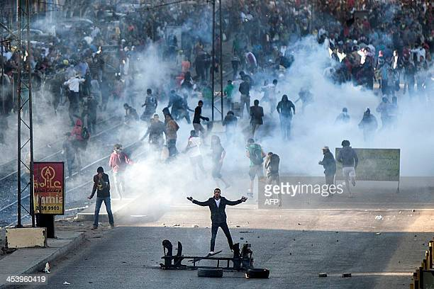Muslim Brotherhood and ousted president Mohammed Morsi supporters clash with Egyptian riot police during a demonstration in the streets of El Zeitun...