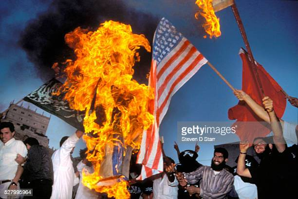 Muslim Brotherhood protestors burn homemade United States flag as part of anti U.S. Demonstration as the U.S. Prepared for war to oust Iraq from...