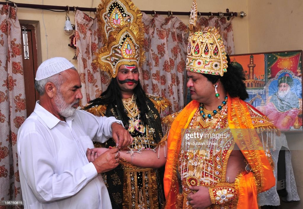 `CHANDIGARH INDIA OCTOBER 15 Muslim brothers Taj Khan and Idam Khan who are playing different characters in Ramleela being helped in dressing up by...