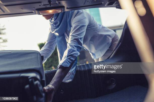 a muslim businesswoman on a business trip - black boot stock pictures, royalty-free photos & images