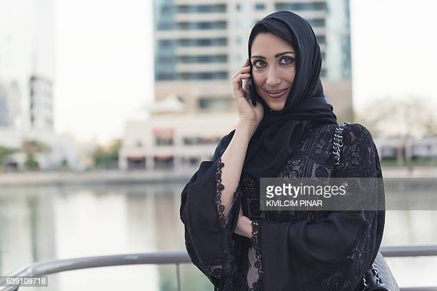Muslim businesswoman on the phone