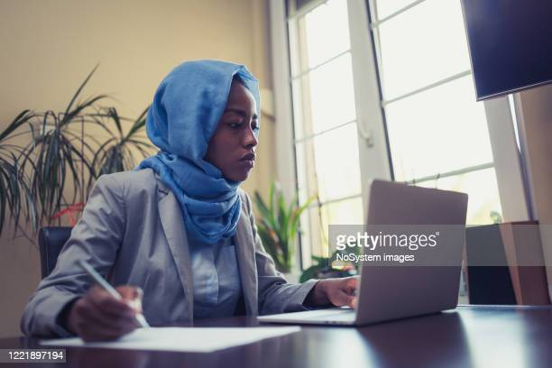 muslim businesswoman working at home - concentration stock pictures, royalty-free photos & images