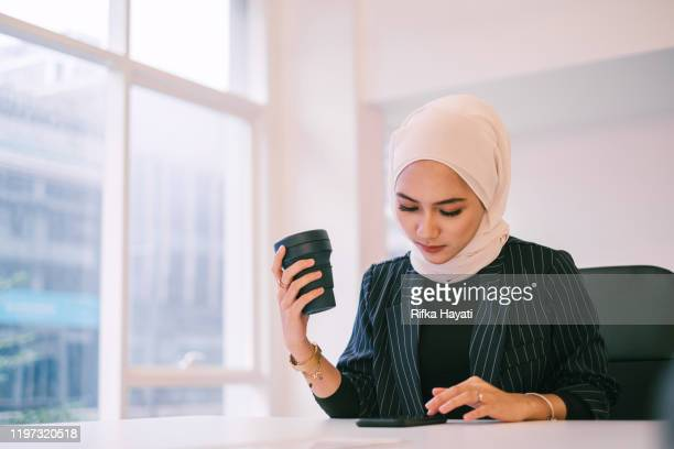 Muslim Businesswomen with Coffee Cup