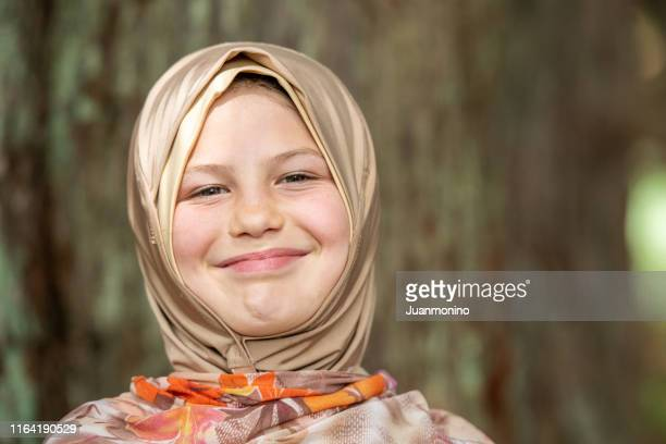 muslim caucasian nine years old child girl wearing a hijab - 8 9 years stock pictures, royalty-free photos & images