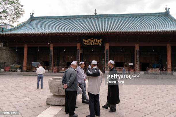 XI'AN SHAANXI PROVINCE CHINA Muslim chat in the square in front of the main hall many of them from other cities such as Yinchuan or Xining come...