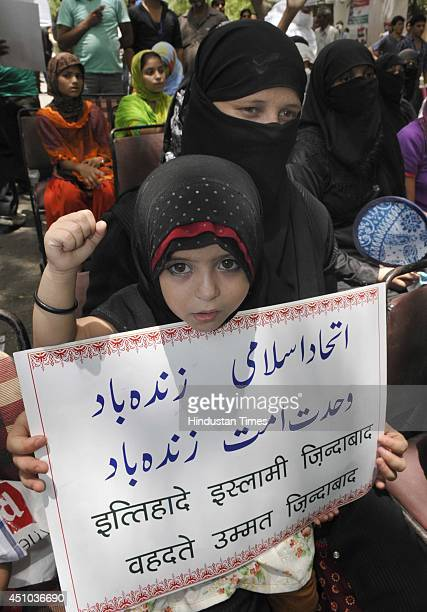 Muslim child holds play card and black flag during a demonstration against terror attacks in Iraq at Jantar Mantar on June 22 2014 in New Delhi India...