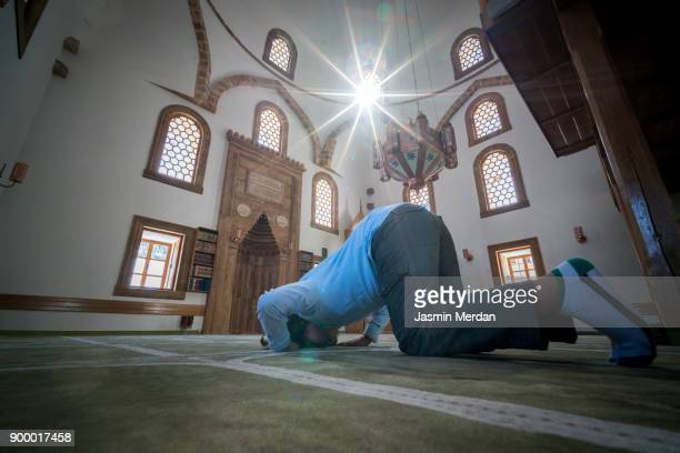 muslim child inside mosque - muslim praying stock pictures, royalty-free photos & images