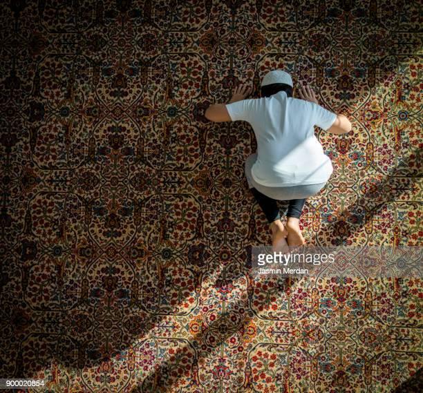 Muslim child inside mosque praying