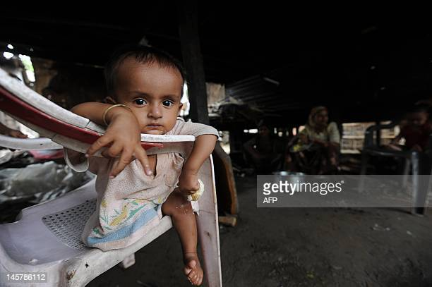 Muslim child is pictured at his house in Sittwe, capital of Myanmar's western Rakhine state on June 6, 2012. An eruption in religious tensions in...