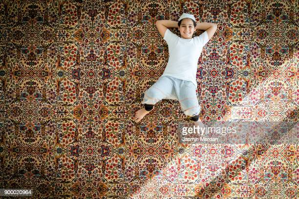 Muslim child relaxed on carpet