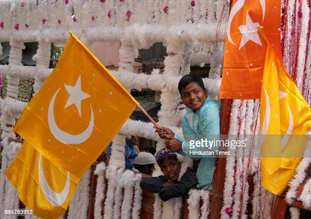 Muslim children hold religious flags as they take part in a procession during Eid MiladUnNabi the birth anniversary of Prophet Muhammad the founder...